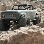 <strong class='magnific-title'>HPI Venture Ambush</strong> HPI Racing Venture running the Proline Ambush body with the Ridge-Line Trail Cage, also has Proline Racing 1.9&quot; Super Swamper® XL Tires wrapped around 2.2 wheels.