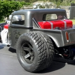 <strong class='magnific-title'>Rat Rod</strong> Thought it looked pretty good, and handles a lot better than the original configuration. Used two Bandit chassis grafted together, Slash suspension, and Pro-Line wheels and tires  (big &amp; little ).