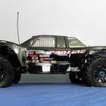 <strong class='magnific-title'>Savage 5T</strong> It's a Savage X converted to 1/5 scale brushless power. Used Trofeo body, Split 6 front wheels and front Trencher tires on all 4 wheels.