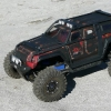 <strong class='magnific-title'>Zombie Killer</strong> Summit LT conversion with Zombie Hunter flat black/blood paintscheme sitting on modified 2.2 TSL Swampers cut to fit Proline F-11 Short Course wheels.  Photo taken on top of Stone Mt GA.