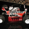 <strong class='magnific-title'>Associated T4 Factory Team</strong> This is one of the first T4 Stadium trucks to use the Pro-Line Power Stroke shocks.  My idea is starting to spread among other forums.  Also are the Square Fuzzie tires (old school and my favorite) and The Edge Pros in the front.