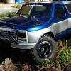<strong class='magnific-title'>Traxxas Slash 4x4 Platinum</strong> This is my Traxxas Slash 4x4 Platinum Edition equipped with Castle Creation's Mamba Max Pro SCT Pro 3800kv brushless system on a Gens Ace 5000mah 3s lipo. The truck rides on Pro-Line Trencher X SC tires mounted on Pro-Line Split Six beadlock wheels.I top this rig off with Pro-Line's 1981 Ford Bronco SC body and it's held up with Pro-line's extended body mount kit.