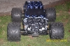 <strong class='magnific-title'>Brushless E-MAXX 3908</strong> It has a custom painted Pro-Line F650 body, painted by Ryan at Adrenaline Art Customs. It also has Pro-Line 23MM hex adapters, Pro-Line Big Joe tires and Pro-Line Cheyenne 40 series bead-loc wheels.