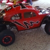 <strong class='magnific-title'>2010 Week: Sep. 11 - Sep. 17</strong> Finished this just after Christmas. Pro-Line Baja body with Pactra paint and Bow-Ties with Split Six bead locks. Pretty beat up now, but still looks cool running around - Derek Palmquist