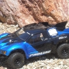 <strong class='magnific-title'>Blue Thunder</strong> Traxxas Slash 2wd, New Flo-Tek Body, Pro-Line Street Fighters mounted on black Split Six wheels.