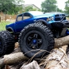 """<strong class='magnific-title'>The Blue Beast</strong> Traxxas E-Maxx 3903, Pro-Line Dodge Ram 1500 body (painted myself, first one!), Pro-Line Ridge-Line bumper set, Pro-Line Trencher 3.8"""" 40 series on Tech 5 Zero rims, Traxxas 17mm hex adapters, Traxxas steel CVD driveshafts and center shafts, Wheelie bar with Traxxas aluminum wheels, Traxxas big bore shocks, 4 RC Raven silver dual rate springs, 4 big bore red springs, 2 2075 waterproof servos, TQI 2.4 radio system, Tacon 2150KV motor, Hobbywing SC8 WP (Waterproof) esc, geared 24/68 currently, 2 x 2s Turnigy 5000mAh 50C batteries."""