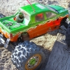 <strong class='magnific-title'>Traxxas Revo</strong> Dodge Mega Cab body, Big Joe tires, Commando wheels. Its powered by Axial .28 and matched up with the Integy Quad exhaust. I painted the body myself using Parma paint.
