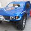 <strong class='magnific-title'>Rocket Pop</strong> 2WD Slash VXL, Pro-Line Ford Raptor body, Pro-Line Switch, Caliber, Slicer, Mohawk, and Sling Shot tires, Pro-Line Epic and Split Six beadlock wheels, RPM bumpers, RC4WD led lights