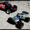 <strong class='magnific-title'>Traxxas Slash</strong> Hi these are my two RC cars a Slash 2wd and a mini Revo. The 2wd is equipped with the ProTrac  suspension kit. When I'm bashing I use the stock wheels and tires, but when racing I use the a set of white Split Six wheels glued to the track with a set of Pro-Line Caliber SC tires. Toping it off is a 14RS body the second body I've painted. The first was the Slipstream for the mini Revo.