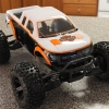 """<strong class='magnific-title'>Harley Stampede 4x4</strong> Traxxas Stampede 4x4 with Pro-Line 2.8 Badlands mounted on Pro-Line 2.8 Black Desperado rims.  Body is a Pro-Line Ford F150 Raptor SVT that I painted in a Harley Davidson """"theme"""""""