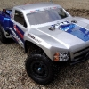 <strong class='magnific-title'>Traxxas Slash 2wd</strong> This is my Slash 2wd truck. The truck has the following Pro-Line upgrades: ProTrac Suspension Kit, Trencher Tires, Split-Six rims, Front Bumper, and the sweet looking Chevy Silverado Body. Thanks again to everybody from Pro-Line Racing.