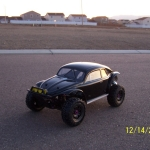 <strong class='magnific-title'>HPI Baja 5t1</strong> Hpi Baja 5t with Pro-Line VW Baja Bug body and Pro-Line Trencher tires mounted on Pro-Line Spit Six wheels. Excellent Job once again Pro-Line. Thank you!