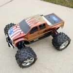 <strong class='magnific-title'>Team Associated Monster GT 4.6</strong> Tim Ware This is my Assoc. MGT, with  Pro-Line Ford F-650 body, Pro-Line Big Joes w/ Pro-Line wheels. Body is painted with Spaztix Color Changing paint along w/ Pactra paint. All of the painting was done by me with rattle cans. All artwork on the body was laid out by hand.