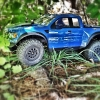 <strong class='magnific-title'>Trail Slash</strong> I have the True Scale Proline Raptor body with rhino lining and plasti dip for the details, Pro-Line Renegade Tires wrapped with Pro-Line Trencher tires. I have the Pro-Line Protrac suspension, Pro-Line Power Stroke Shocks, Pro-Line Chassis Saver, and Pro-Lines awesome tranny. Pro-Line, you are awesome!