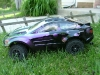 <strong class='magnific-title'>Traxxas Slash 2 wheel drive</strong> This is my Basher! It is a Traxxas Slash with a Pro-Line 14RS Body with Pactra Purple Crush color change and Pactra Outlaw Black paint. Pro-Line Pro Pulls holds everything down. I have a Traxxas Velineon system with a Pro-tek 3300 3S Li-Po. A Traxxas Wheelie bar mounted on a Pro-Line Rear Skid Plate/ Wheelie Bar Mount keeps my Slash on the ground. To make everything stable I have a Pro-Line ProTrack Suspension Kit with ST Racing Concepts Lock-Nut Hinge Pins and Pro-Line Trenchers put the power to the road! For Extra strength I added ST Racing Concepts Red Aluminum Caster Blocks and Red Aluminum Steering blocks. I also have Blue RPM Spring Retainers, Spring Spacers, and Gear Cover.