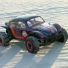 <strong class='magnific-title'>Pioneer/Gulf Baja</strong> This VXL-powered 2WD Slash Baja Bug tears it up on Sunset Beach, NC - a tiny 2-mile barrier island! The decal scheme is all '70s retro Baja 1000 with a 21st century prismatic paint job.