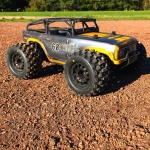 """<strong class='magnific-title'>Pro-Line PRO-MT 4x4 Ambush</strong> First roller, first body paint, first time out with this build. Totally aprocheable and rugged, so much fun!!! Pro-Line MT 4x4 Ambush roller, Pro-Line aluminum shock cap upgrades, ProLine aluminum shock mount upgrade, Pro-Line metal gear upgrade, 18T Mod 1 pinion gear, 1M center diff fluid, distressed aluminum body paint, Pro-Line 4"""" light bar, Castle 1515 2200 sensored motor, Castle Mamba Monster X ESC, Savox hi-torque servo, Futaba 4PLS radio, 4s LiPo."""