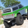 <strong class='magnific-title'>Green Spectrum</strong> This is my SCX10 with Pro-Line 73 Ford Bronco Body. Paint job is Indy Silver and Lime Ice Green. It has Pro-Line roof rack and Axial Dingo fenders, which are painted to match. Axial Honcho front bumper and a Dingo back bumper. The truck has Robinson Racing gears, MIP drive lines, Axial aluminum axle parts front and rear, Castle BEC, Tekin ESC, SR300 receiver,DX3C radio, Pro-Line Titus 2.2 Wheels with Rox Lox tires and SWX 4-link.