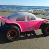 """<strong class='magnific-title'>Slash 2wd Baja Brushless</strong> Hi, Here are some pics of my Slash 2wd, on the Beach of """"l'Espiguette"""" in the south of the France, near """"Montpellier"""". It uses Pro-Line Baja body for Slash 2wd, Pro-Line Bead Lock Wheels, and of course the best tires on earth, Pro-Line Badlands SC tires !"""