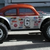 <strong class='magnific-title'>Rustler/Slash hybrid baja bug</strong> Here's my Rustler/Slash hybrid baja bug -- featuring short chassis Pro-Line baja bug body, ProTrac wheels, and Switch tires.